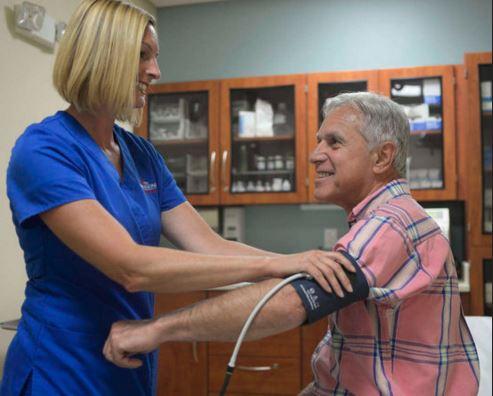 Cape Regional Urgent Care nurse and patient